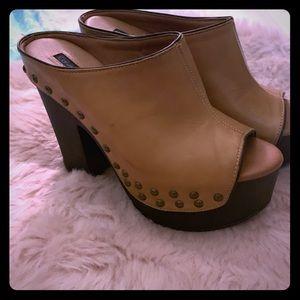 Calvin Klein brown leather mule platforms